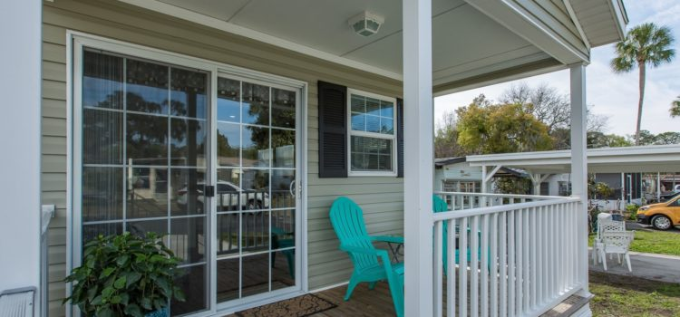 Beautiful sliding glass doors open to your large porch