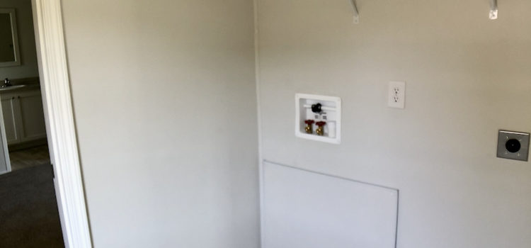 Utility room with washer/dryer hook-ups