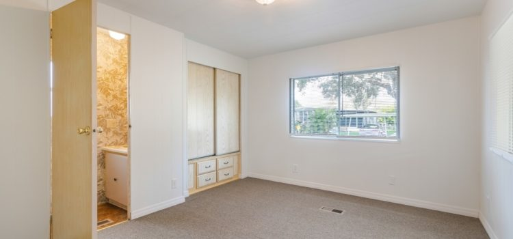 Master bedroom with built-in shelving/storage space