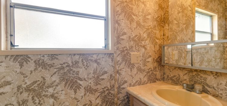 Half bath with tropical wallpaper